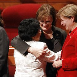 Sister Silvia H. Allred , Sister Linda K. Burton, and Sister Julie B. Beck hug after the 182nd Annual General Conference for The Church of Jesus Christ of Latter-day Saints at the LDS Conference Center in Salt Lake City on Saturday, March 31, 2012.