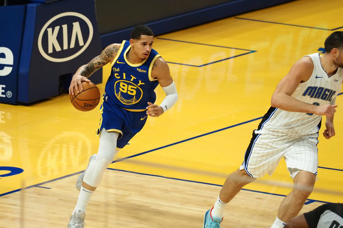 Golden State Warriors forward Juan Toscano-Anderson (95) controls a rebound against the Orlando Magic during the first quarter at Chase Center.