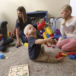 Grace, Camilla, James and Mary Grant play at home in Midvale, Utah, on Monday, Sept. 9, 2019.
