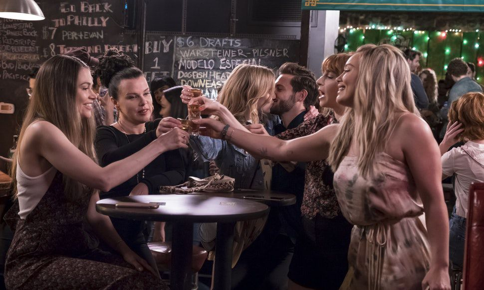 A still of 'Younger' characters at the bar