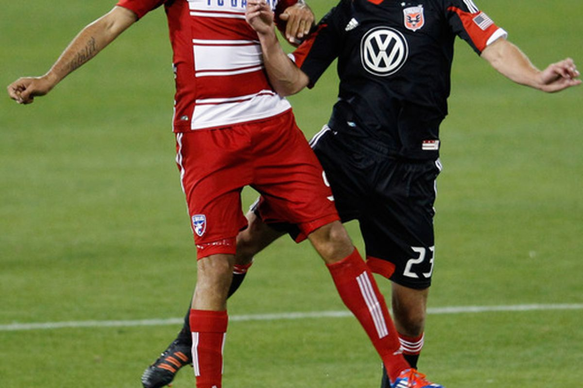 WASHINGTON, DC - MARCH 30: Blas Perez #9 of the FC Dallas and Perry Kitchen #23 of the D.C. United go up for a header at RFK Stadium on March 30, 2012 in Washington, DC.  (Photo by Rob Carr/Getty Images)