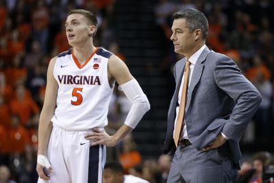 Kyle Guy with coach Tony Bennett