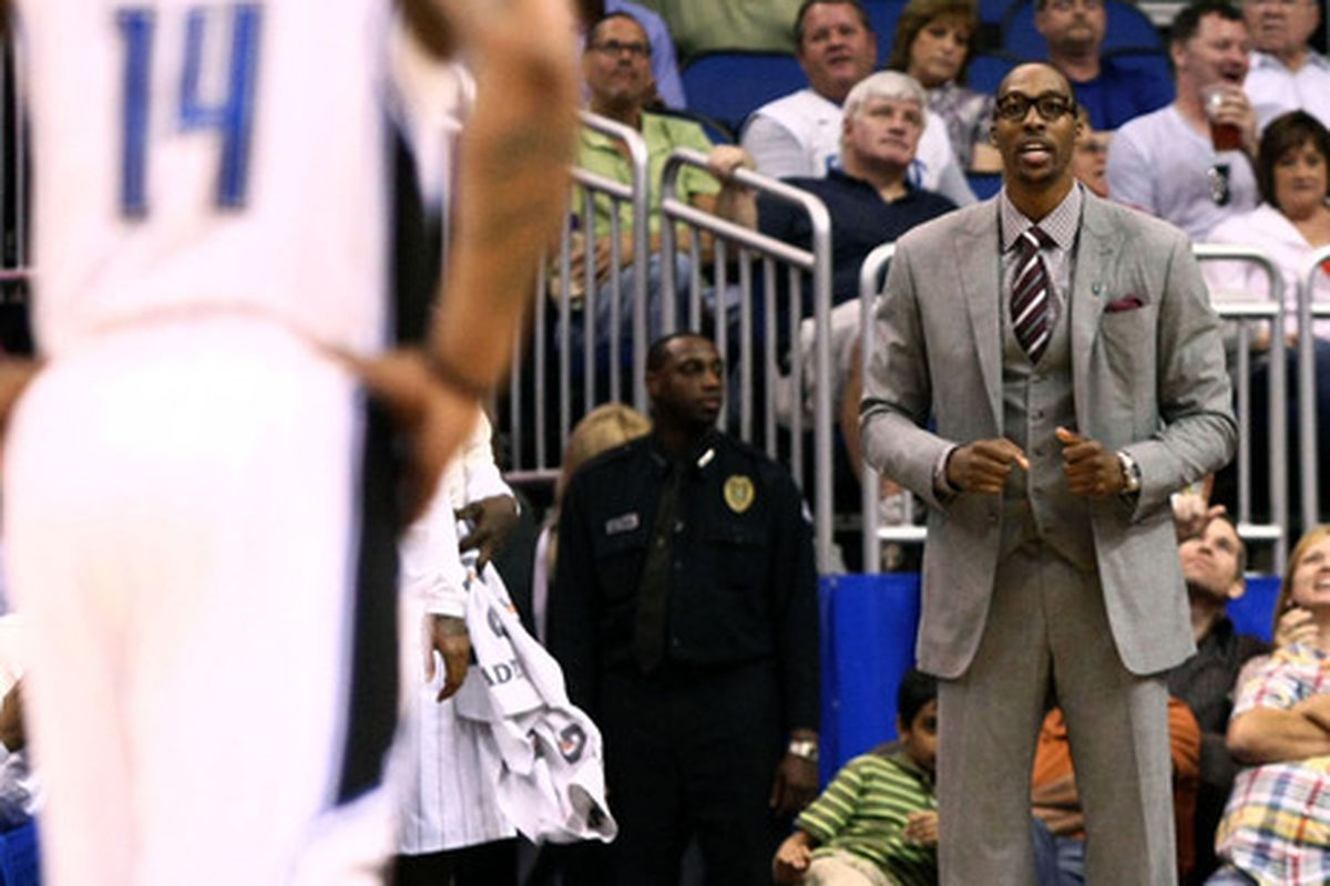 Apr 9, 2012; Orlando, FL, USA; Orlando Magic center Dwight Howard (right) gives encouragement to point guard Jameer Nelson (14) during the third quarter at Amway Center. Orlando defeated Detroit 119-89. Mandatory Credit: Douglas Jones-US PRESSWIRE