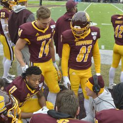 JaCorey Sullivan, Ben Maleszyk, Alec Muck and the rest of the CMU receivers receive instructions from their receivers coach.