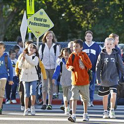 King Elementary School students and parents join the International Walk to School Event promoting safety walking to school.