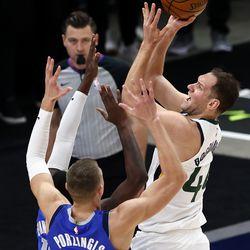 Utah Jazz forward Bojan Bogdanovic (44) pushes up a shot over Dallas Mavericks forward Kristaps Porzingis (6) as the Utah Jazz and the Dallas Mavericks play an NBA basketball game at Vivint Smart Home Arena in Salt Lake City on Wednesday, Jan. 27, 2021.