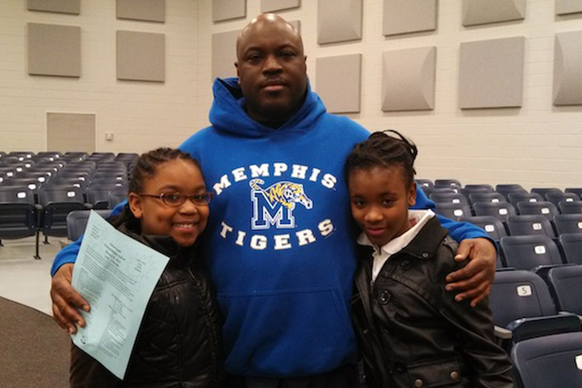 Kenneth Woods and his daughters Breanna Rosser (r) and Taylor Woods (r) reviewed 12 powerful words with sixth grade language arts teacher Patricia Hervey.