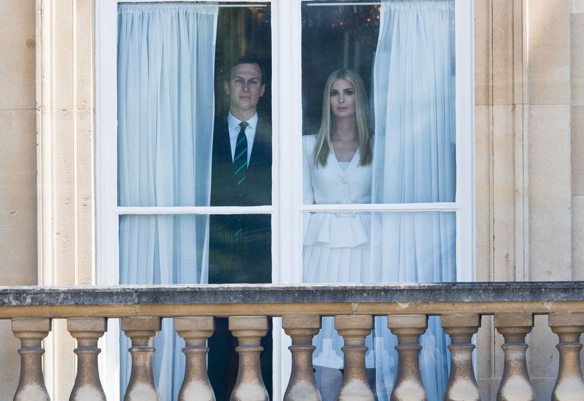Jared Kushner and Ivanka Trump watch the ceremonial welcome from a window at Buckingham Palace on June 03, 2019 in London, England.