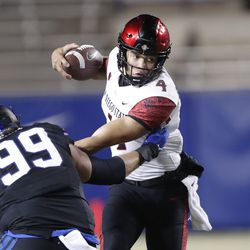 San Diego State quarterback Jordon Brookshire (4) is sacked by BYU defensive lineman Zac Dawe (99) in the first half of an NCAA college football game Saturday, Dec. 12, 2020, in Provo, Utah.
