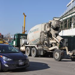 Concrete truck entering the triangle lot from Clark Street -
