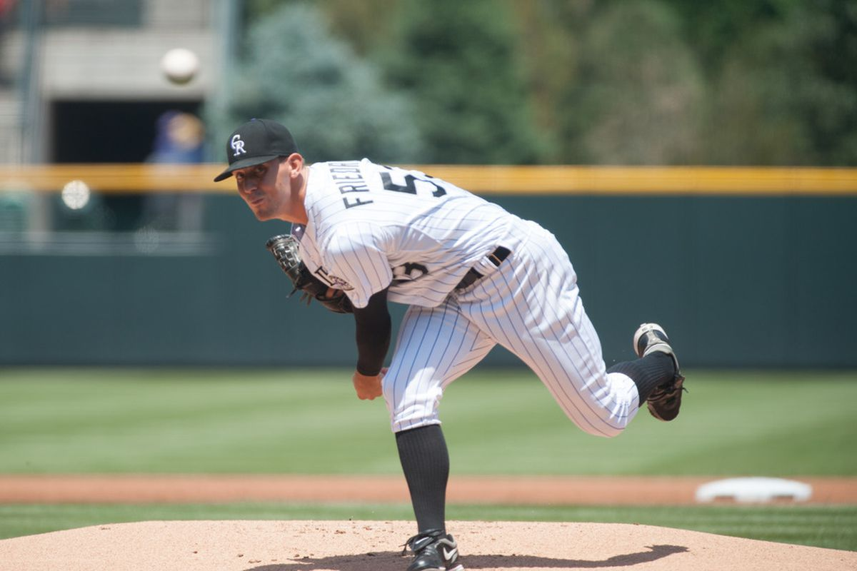 DENVER, CO - JUNE 10:  Christian Friedrich #53 of the Colorado Rockies pitches in the first inning during an interleague game against the Los Angeles Angels at Coors Field on June 10, 2012 in Denver, Colorado.  (Photo by Dustin Bradford/Getty Images)