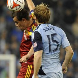 Real Salt Lake's Luis Gil heads the ball in front of Sporting KC's Seth Sinovic during a game at Sporting Park in Kansas City, Kan., on Saturday, April 5, 2014.