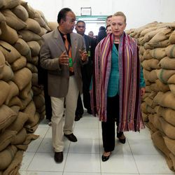 U.S. Secretary of State Hillary Rodham Clinton, right, talks with Agribusiness Advisor Bency Isaac, left, as she tours the Timor Coffee Cooperative in Dili, East Timor Thursday, Sept. 6, 2012. U.S. Secretary of State Hillary Rodham Clinton is in East Timor to offer the small half-island nation support as it ends its reliance on international peacekeepers.
