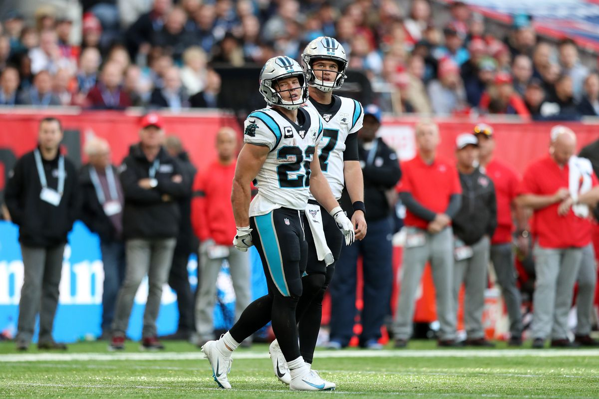 Christian McCaffrey speaks with Kyle Allen of Carolina Panthers during the NFL game between Carolina Panthers and Tampa Bay Buccaneers at Tottenham Hotspur Stadium on October 13, 2019 in London, England.