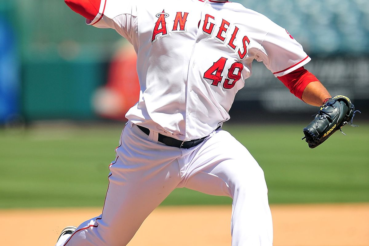 August 12, 2012; Anaheim, CA, USA; Los Angeles Angels relief pitcher Ernesto Frieri (49) pitches in the ninth inning against the Seattle Mariners at Angel Stadium. Mandatory Credit: Gary A. Vasquez-US PRESSWIRE