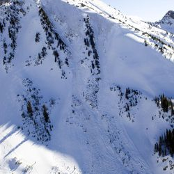 An avalanche's path is seen in Little Cottonwood Canyon on Tuesday, Dec. 20, 2016. The avalanche occurred when two backcountry skiers descended the mountainside, prompting a response from Unified Police, Backcountry Rescue, Alta marshals and the DPS helicopter.