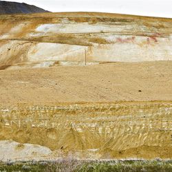 Dozers work on the east facing side of the Bingham Copper Mine on Thursday, May 26, 2011.