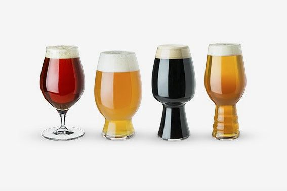 A set of four assorted beer glasses