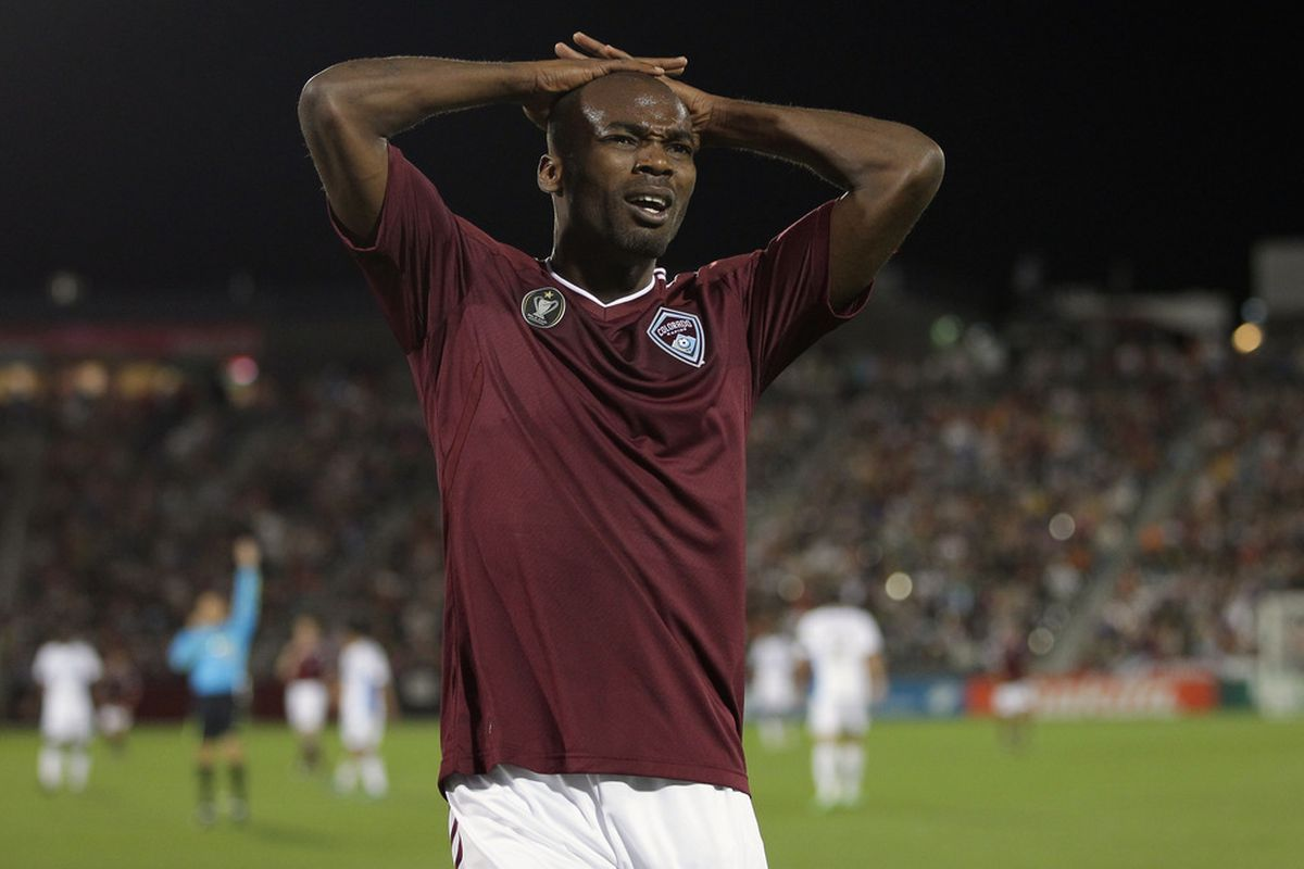 COMMERCE CITY, CO - SEPTEMBER 24:  Omar Cummings #14 of the Colorado Rapids sums up Burgundy Wave's feelings on the whole evening. We love you Omar.  (Photo by Doug Pensinger/Getty Images)