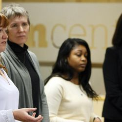 Panelists Yvette Young, left, Yda Smith, Carine Foly and Samira Harnish participate in a forum on women refugees at the Lowell Bennion Community Service Center at the University of Utah in Salt Lake City on Tuesday, Dec. 8, 2015.