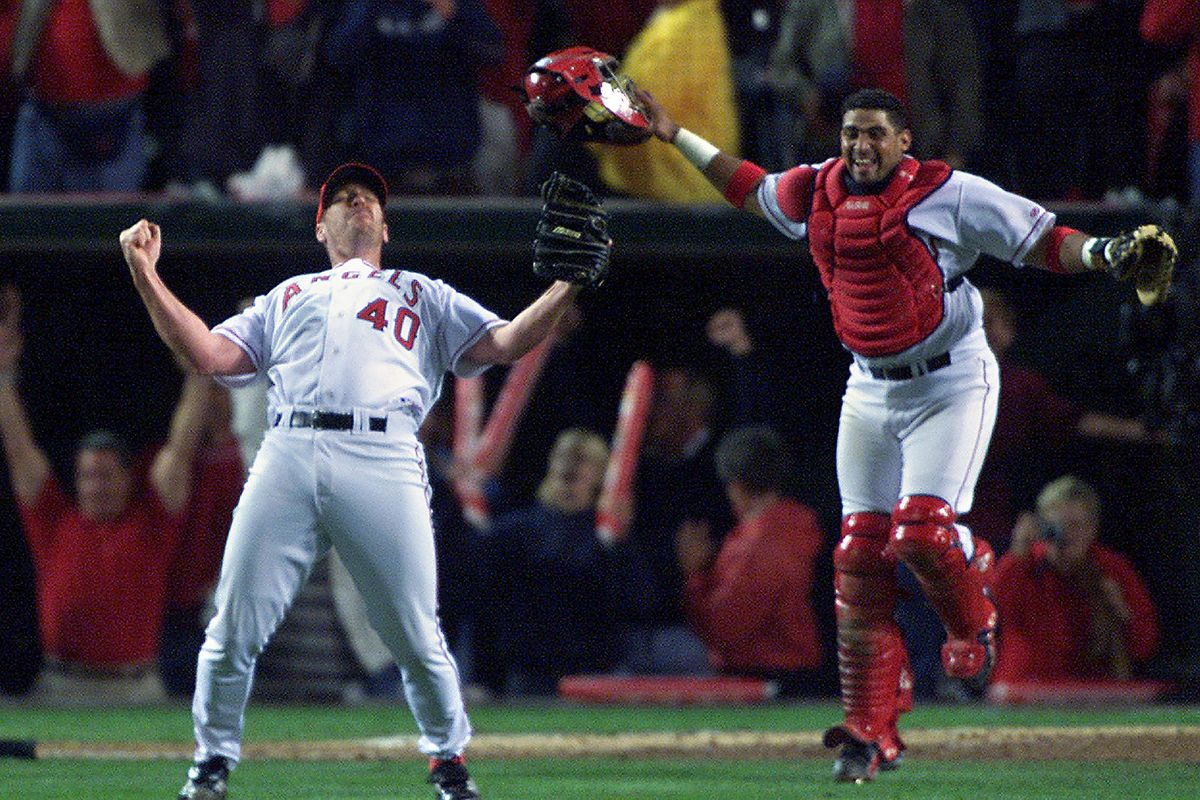 ANGELS/GIANTS; Angel relief pitcher Troy Percival and catcher Bengie Molina celebrate their game sev