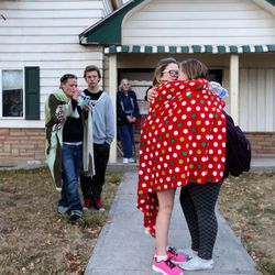 Parents and their children meet each other after a lockdown at the high school was lifted Thursday, Dec. 3, 2015. Pleasant Grove High School was placed on lockdown after receiving reports of a man with a weapon inside the school.