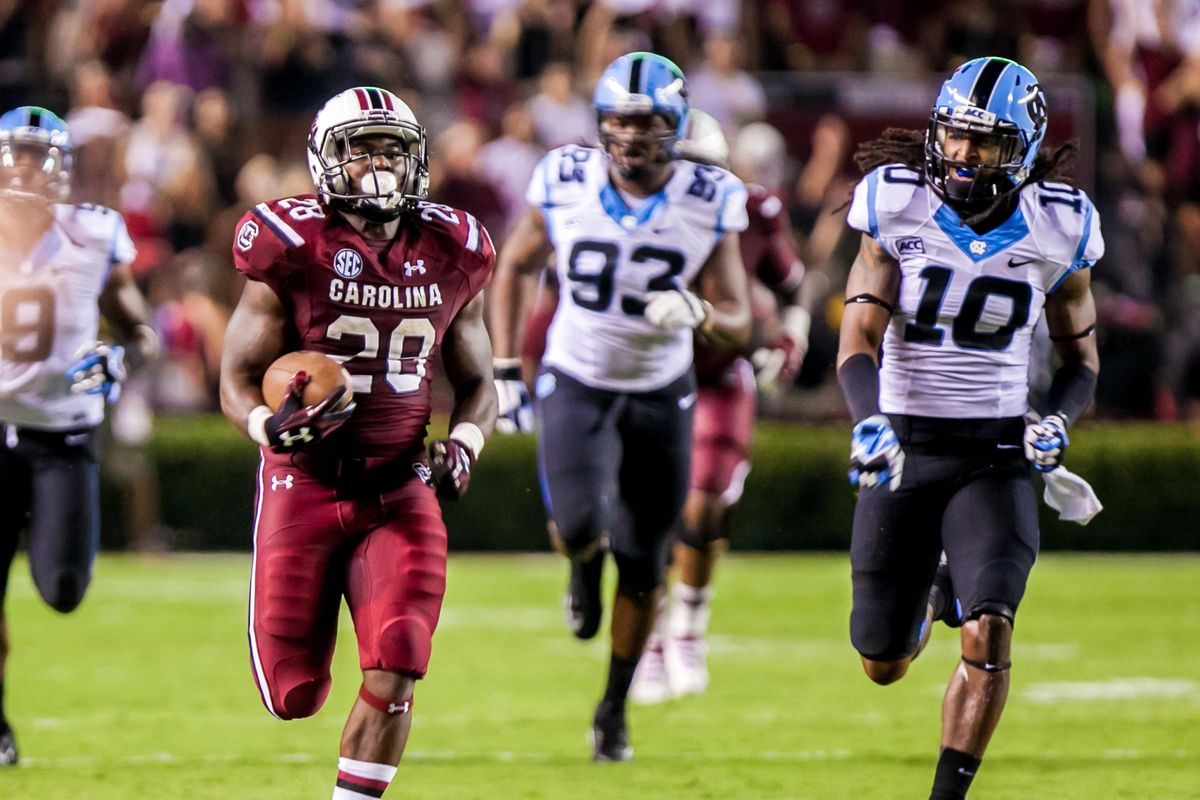 Mike Davis takes a simple play call to the house against North Carolina in the Gamecocks' 27-10 win.
