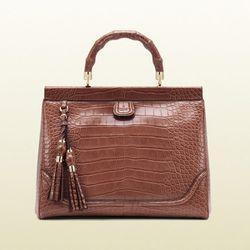 "<b>Gucci</b> Bold Bamboo Pink Crocodile Top Handle bag, <a href=""http://www.gucci.com/us/styles/296860EJ50G6317?utm_source=J84DHJLQkR4&utm_medium=affiliates&utm_campaign=1&utm_content=4&siteID=J84DHJLQkR4-HOnyYtqksilMigscfxe0ZQ#296860EJ50G6317"">$24,000</a"