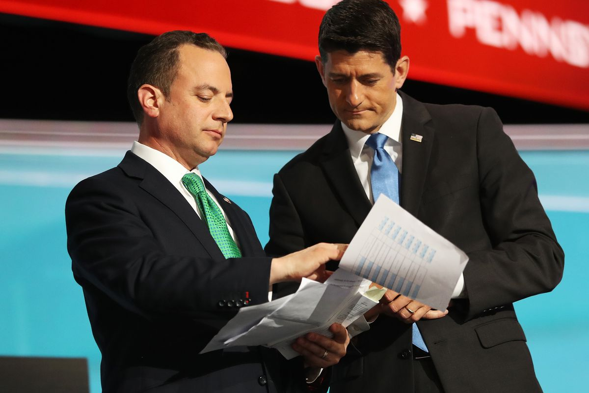 CLEVELAND, OH - JULY 19:  Reince Priebus, chairman of the Republican National Committee, (L) and Speaker of the House Paul Ryan consult one another about the recount of Alaska delegation votes after roll call on the second day of the Republican National Convention on July 19, 2016 at the Quicken Loans Arena in Cleveland, Ohio. Republican presidential candidate Donald Trump received the number of votes needed to secure the party's nomination. An estimated 50,000 people are expected in Cleveland, including hundreds of protesters and members of the media. The four-day Republican National Convention kicked off on July 18.  (Photo by Joe Raedle/Getty Images)