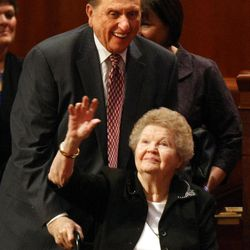 President Thomas S. Monson and his wife, Frances, leave the General Relief Society Meeting at the Conference Center on Saturday.