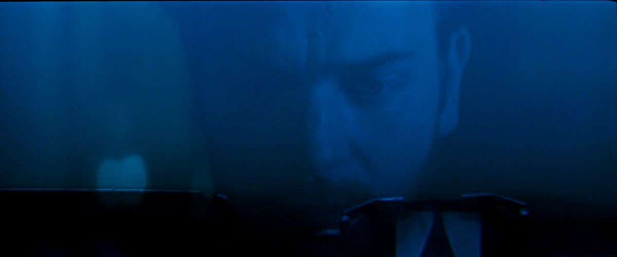 Ewan McGregor, in dim blue light, hunches over a typewriter in Moulin Rouge
