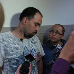 Christian Mercado, left, a Milwaukee man whose pregnant wife was killed last year by a woman who carved out his wife's fetus in hopes of raising the boy as her own, struggles for words on Thursday, Sept. 20, 2012, minutes after a jury convicted the suspect of two counts of intentional homicide. Family friend Penelope Solis, right, said Mercado and his three kids were still struggling to cope with the attack.