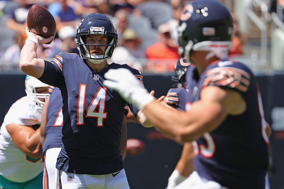 Andy Dalton (14) throws a pass to tight end Cole Kmet for a three-yard gain in the first quarter of the Bears' 20-13 victory over the Dolphins on Saturday at Soldier Field.