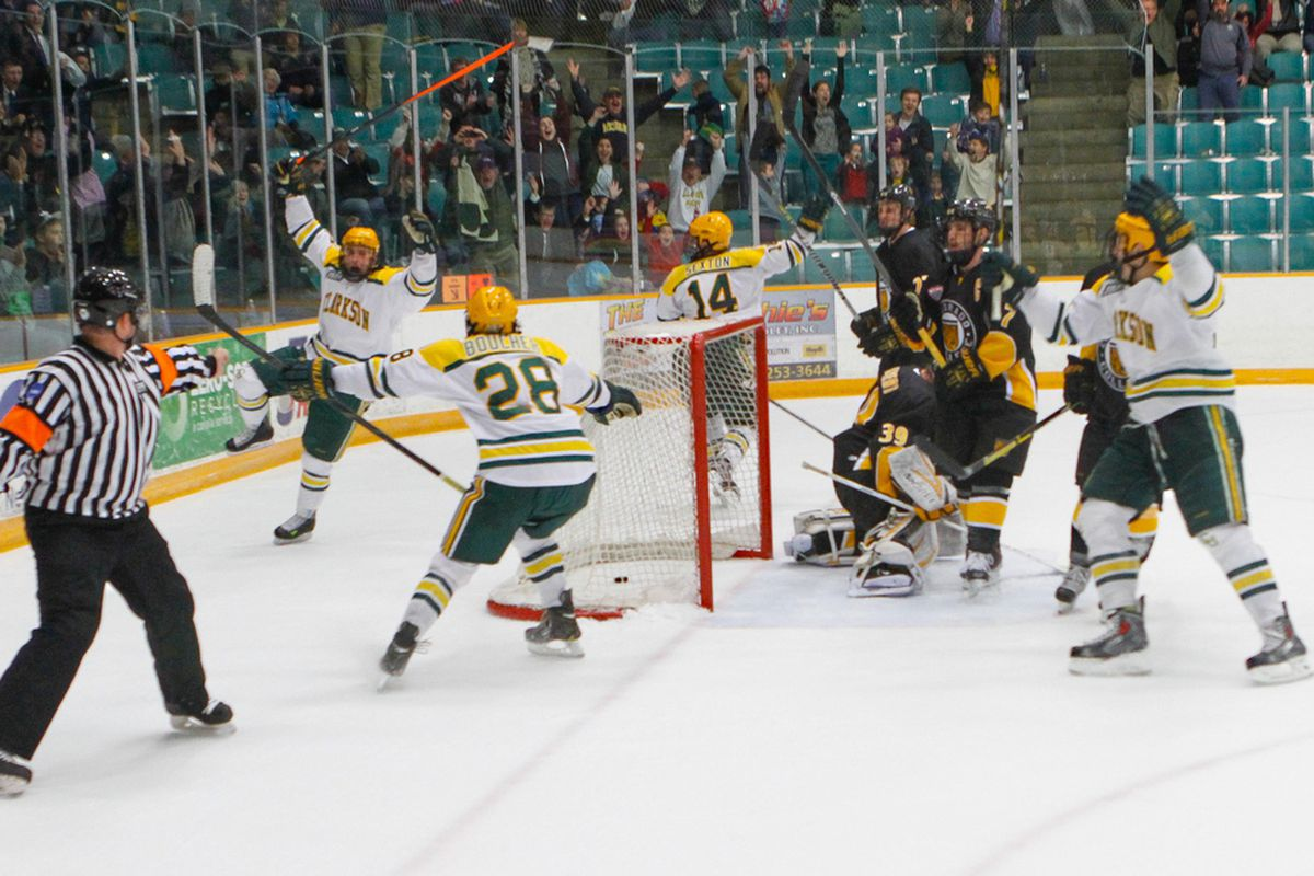 Clarkson players celebrate a Joe Zarbo overtime goal this past season against Colorado College.