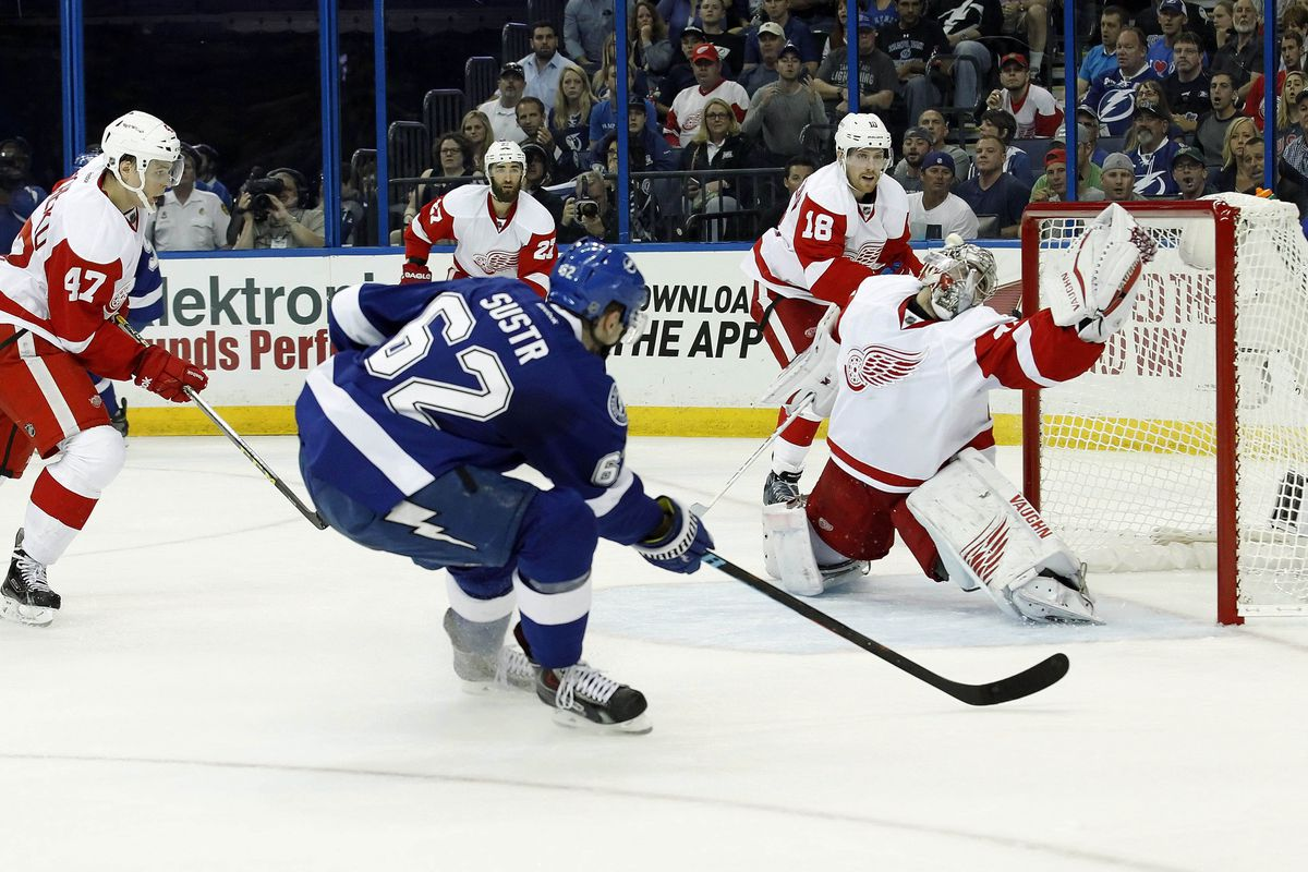 The Lightning's Andrej Sustr scores during Tampa Bay's 5-1 win over Detroit to tie their playoff series at one.