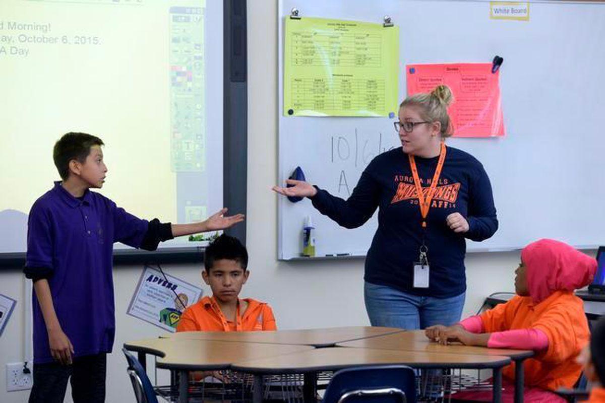 Teacher Alice Wilcox leads an English language development class at Aurora Hills Middle School in 2015. (Kathryn Scott Osler, The Denver Post)