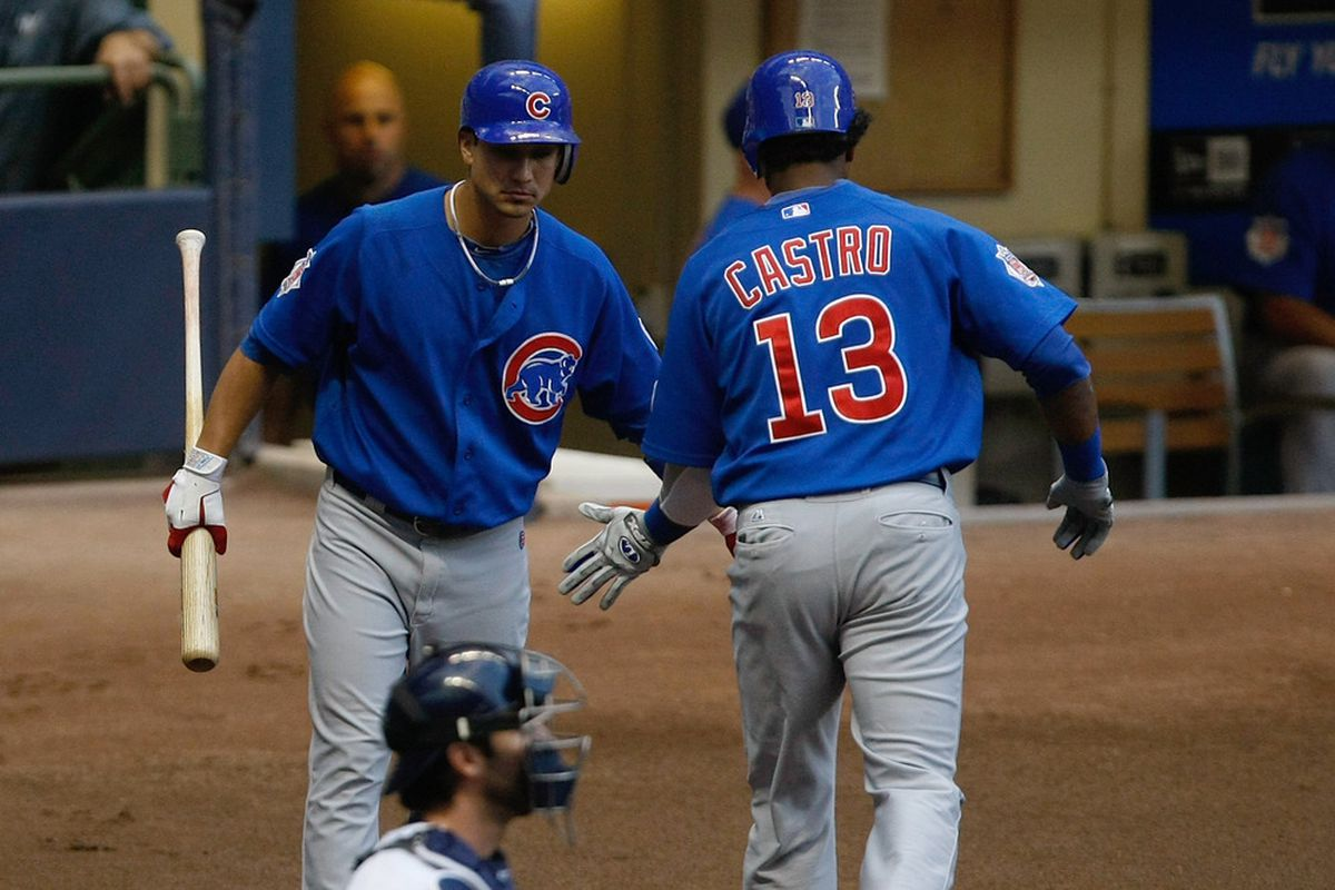 Starlin Castro of the Chicago Cubs is congratulated by Darwin Barney after hitting a home run during a game against the Milwaukee Brewers at Miller Park in Milwaukee, Wisconsin. (Photo by Scott Boehm/Getty Images)