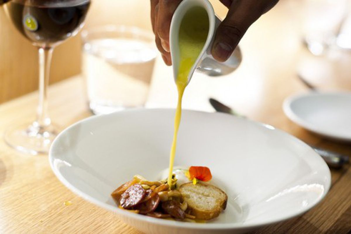 """Mussel soup at Aldea by <a href=""""http://www.flickr.com/photos/nicknamemiket/5559755755/in/pool-eater/"""">nicknamemiket</a>."""