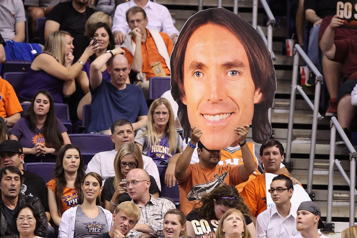 PHOENIX, AZ - APRIL 25:  A fan holds up a Seve Nash #13 of the Phoenix Suns sign during the NBA game against the San Antonio Spurs at US Airways Center on April 25, 2012 in Phoenix, Arizona.   (Photo by Christian Petersen/Getty Images)