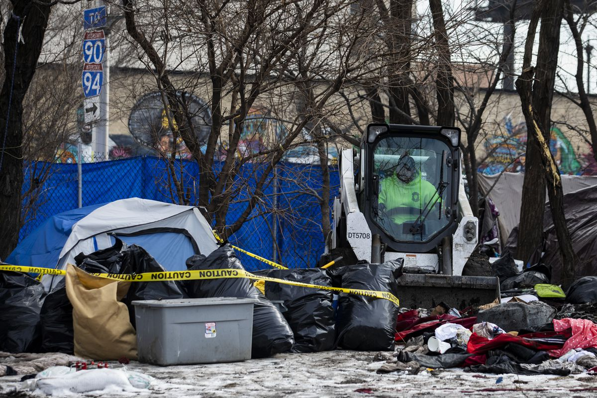 Workers from the city's Department of Streets and Sanitation clear out a homeless encampment near South Desplaines Street and West Roosevelt Road on Monday morning.