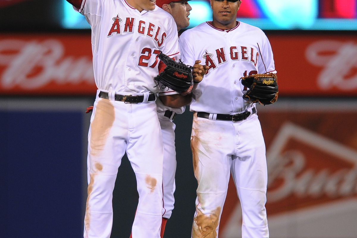 Aug 15, 2012; Anaheim, CA, USA; The Los Angeles Angels celebrate after the game against the Cleveland Indians at the Angel Stadium of Anaheim. The Los Angeles Angels defeated the Cleveland Indians 8-4. Mandatory Credit: Kelvin Kuo-US PRESSWIRE