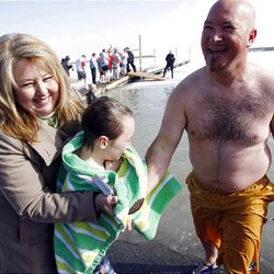DiAnn Mott wraps up grandson David Hall with a warm towel after he and his father, Kelly Hall, jumped into Utah Lake Saturday for the Polar Plunge, which raised $14,000 for Special Olympics Utah.