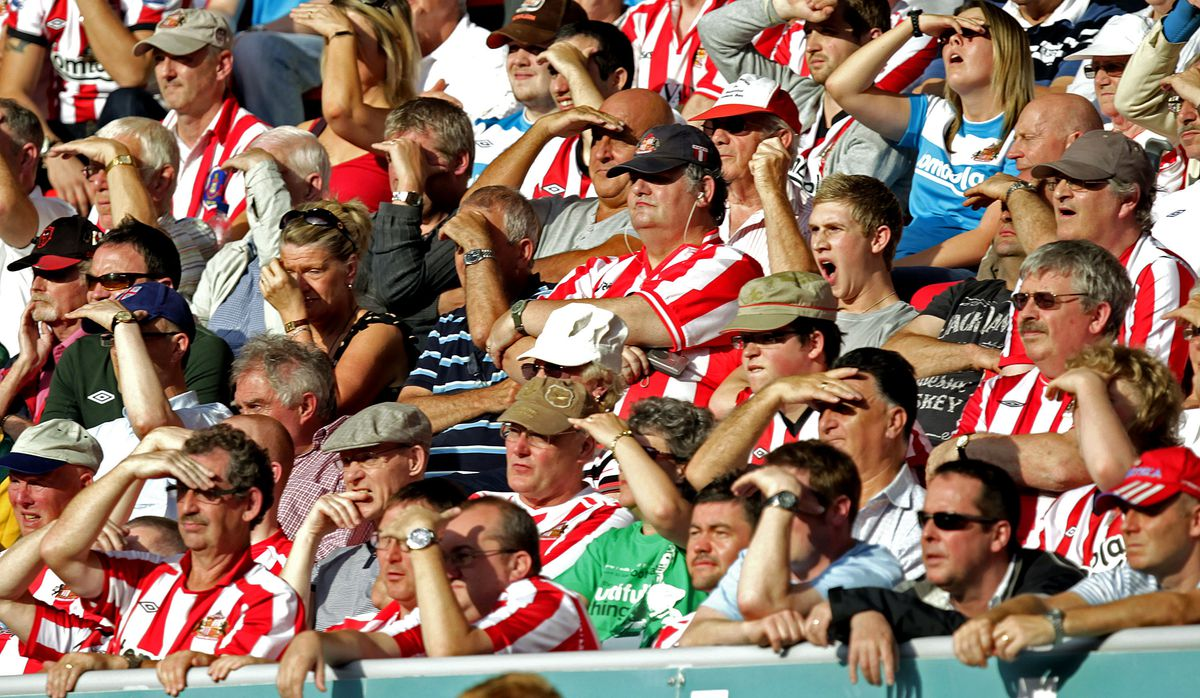 Sunderland's fans watching in the sunshi