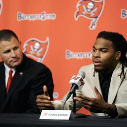 New Tampa Bay Buccaneers safety Mark Barron speaks to the media while head coach Greg Schiano, looks on from left, Friday, April 27, 2012, during a news conference introducing them to the media in Tampa, Fla.  The Buccaneers selected the All-American who helped Alabama win two national titles with the seventh pick of the NFL draft on Thursday.
