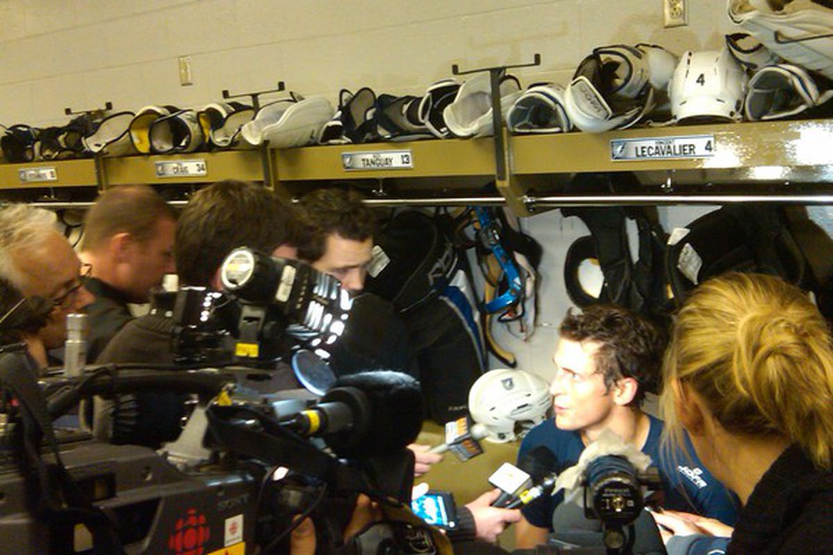 """An annual rite of passage:  Vincent Lecavalier being inundated at his locker by Montreal media as the Lightning visit the Habs.  (Photo via <a href=""""http://twitter.com/TBLightning/"""">@tblightning </a>)"""