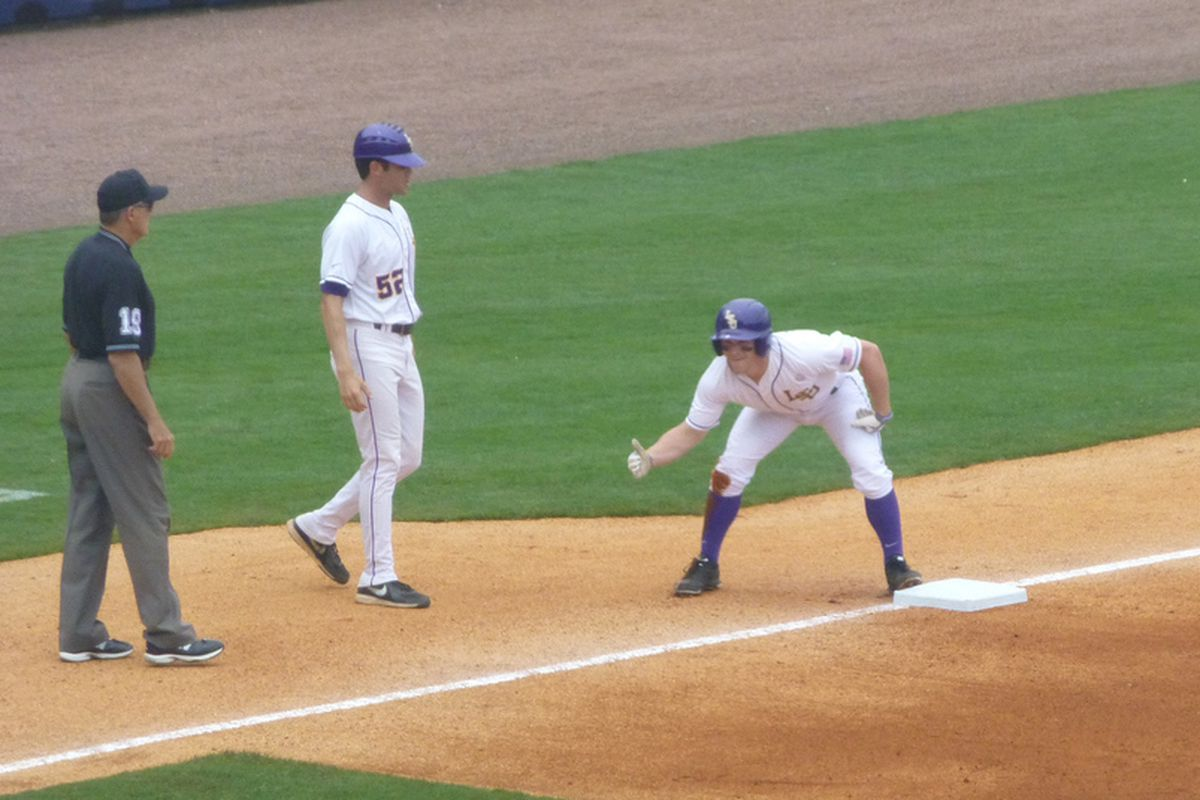 Sean McMullen leads off the game by reaching 3B on a error