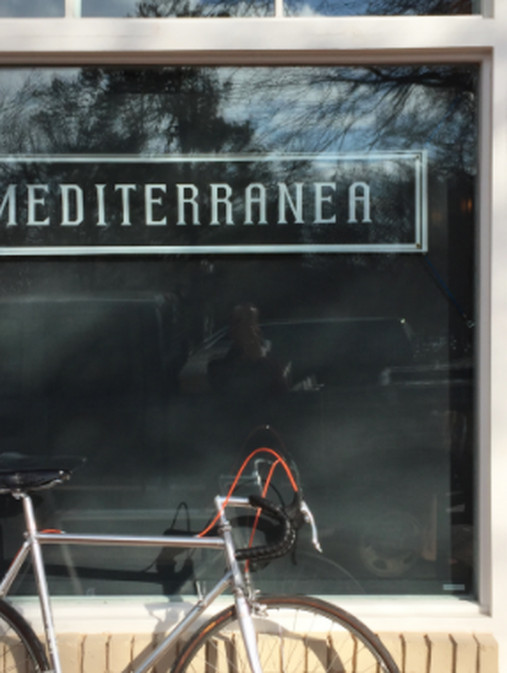 Window signage at Mediterranea