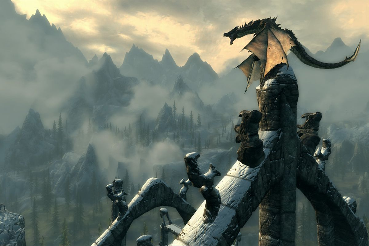 Skyrim - a dragon perched up on a castle spiral roars menacingly. In the distance are mountains and sky.