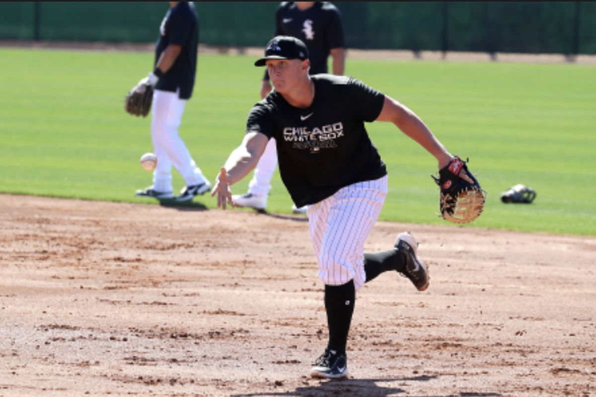Andrew Vaughn goes through fielding drills at first base at White Sox spring training camp Monday.