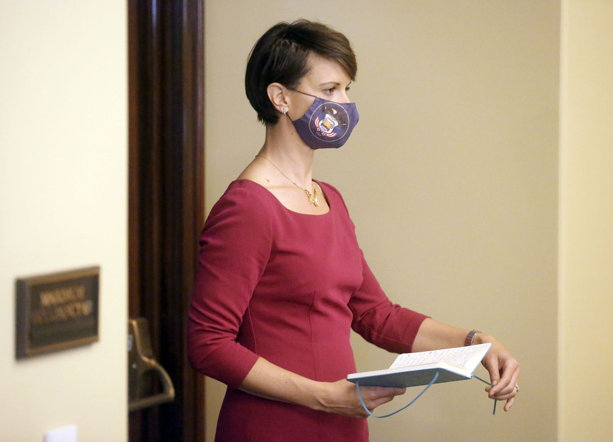 State epidemiologist Dr. Angela Dunn walks to the podium to speak during a COVID-19 press conference at the Capitol in Salt Lake City on Thursday, Oct. 8, 2020.